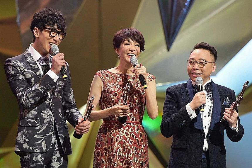 Hosts (above) Carol Cheng and hip-hop duo Fama's 6-Wing (left) and C-Kwan kept the atmosphere lively.