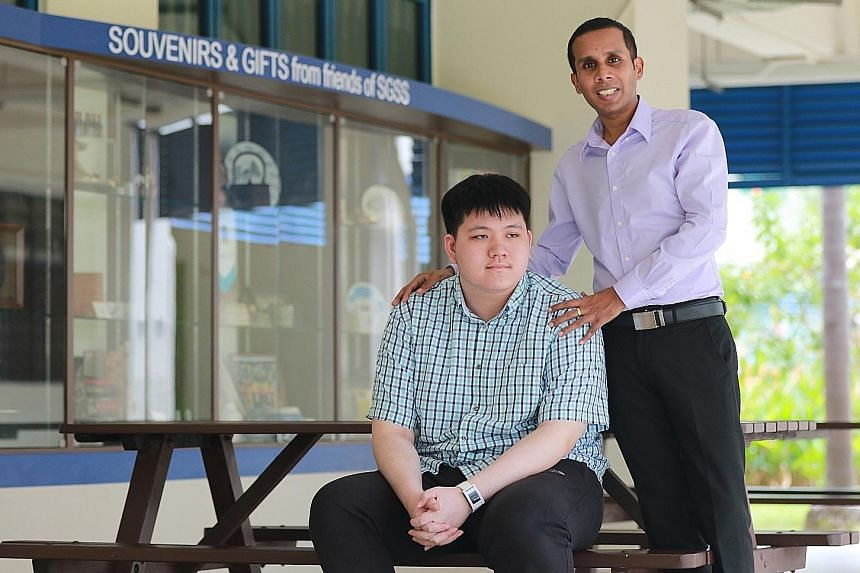 Mr Jeyaram with Mr Tay at St Gabriel's Secondary, where teacher and student once laboured tirelessly to overcome daunting hurdles. Support from the school and all his teachers enabled Mr Tay to score seven distinctions at O levels.