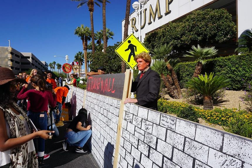 An anti-Trump gathering outside the Trump International Hotel in Las Vegas last week. Current polling puts Democratic candidate Hillary Clinton ahead in Nevada, with The New York Times giving her a 78 per cent chance of clinching the state. Ms Ha sup