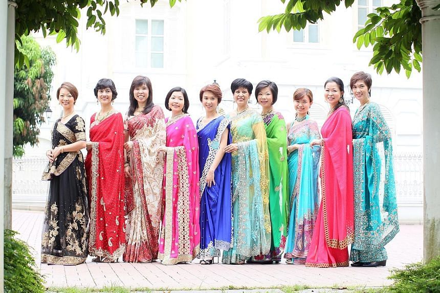 Members of Parliament (from left) Foo Mee Har, Joan Pereira, Jessica Tan, Cheryl Chan, Low Yen Ling, Indranee Rajah, Sim Ann, Tin Pei Ling, Cheng Li Hui and Josephine Teo were among the group of 16 female MPs who wore saris for a Tamil Murasu photo s