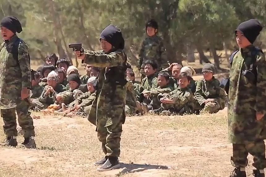 Children undergoing training by the Islamic State in Iraq and Syria (ISIS) to become soldiers, as shown in propaganda footage posted online by the terrorist group.