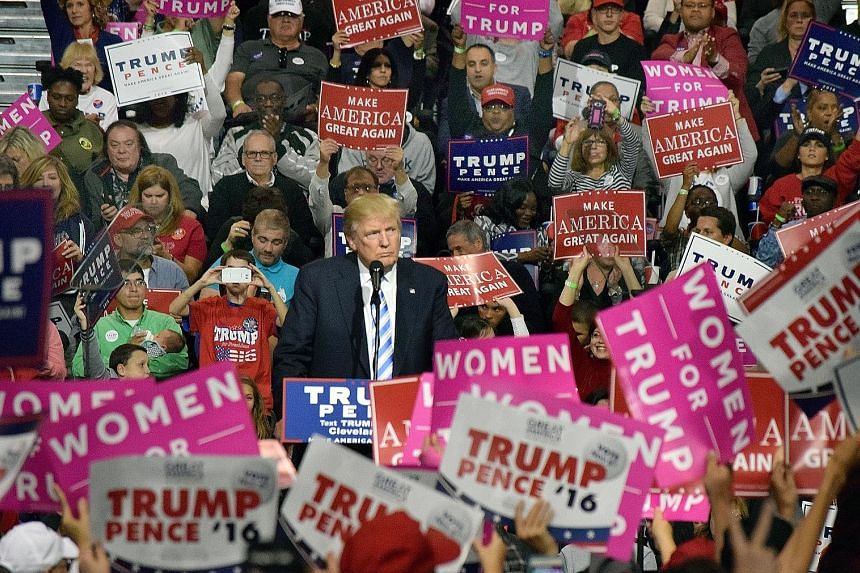 Mr Trump at a campaign rally in Cleveland on Saturday. In Gettysburg, he did not offer much in the way of race-changing oratory and did not seem to embrace former US president Abraham Lincoln's unifying ambition. He largely repeated his existing camp