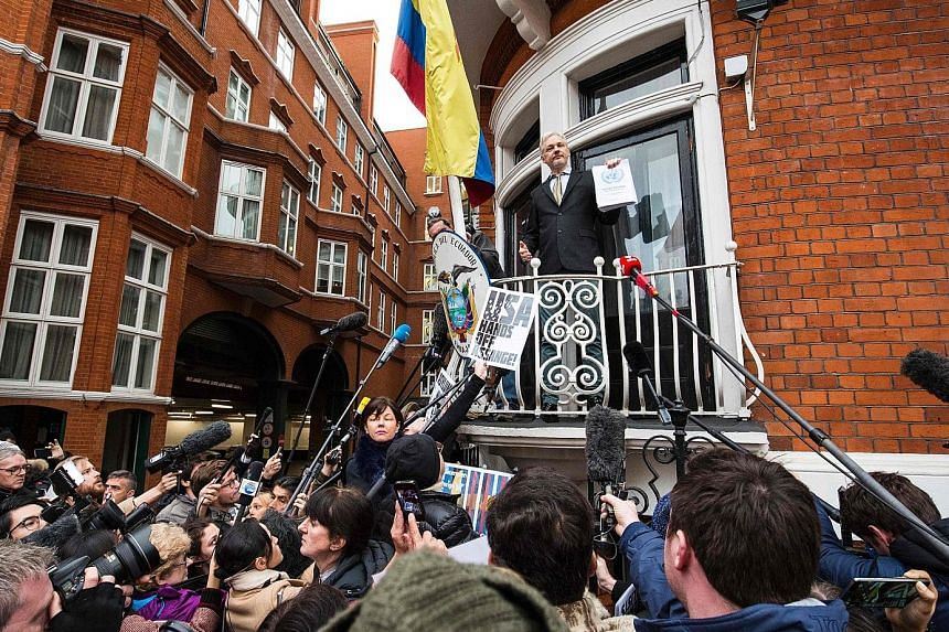 Mr Assange addressing media from the balcony of the Ecuadorean Embassy in London in February. He sought political asylum there in 2012 and has not left the premises since, claiming he could be deported.