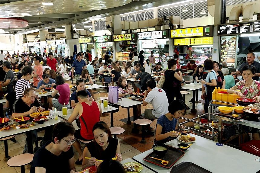 Stallholders at the Ang Mo Kio Block 628 market and food centre (left) who stuck it out through their ordeal, believe there is reason to be optimistic. Business returned, even at a temporary location, and when the new building was completed, it was m