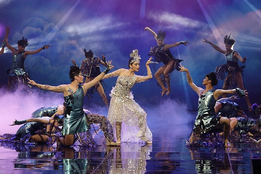 Actress Zoe Tay (centre) performing a peacock-themed dance at the 17th President's Star Charity show last night, which raised a record $7.37 million, nearly $1 million more than last year. Proceeds will go to 58 charities supported by this year's Pre