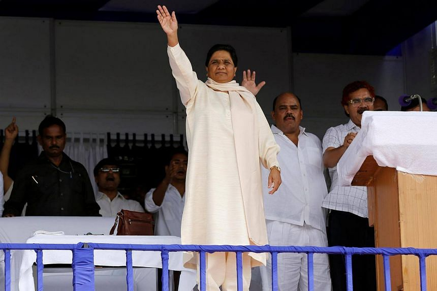 Bahujan Samaj Party (BSP) chief Mayawati waves to her supporters during an election campaign rally.