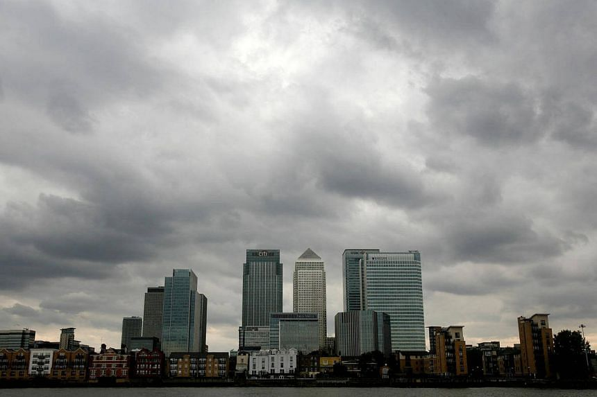Storm clouds are seen above the Canary Wharf financial district in London, Britain, on Aug 3, 2010.