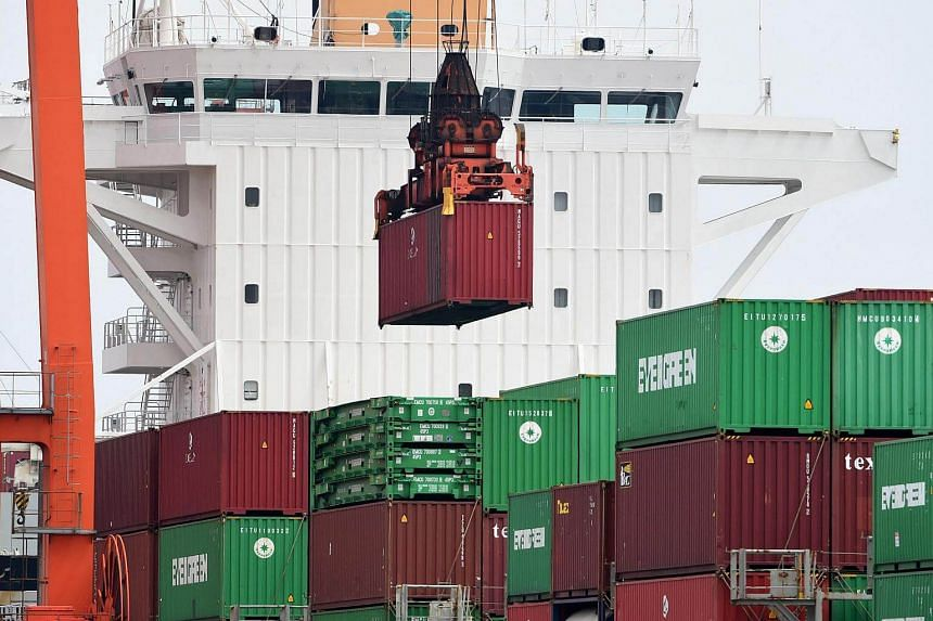 A container being unloaded from an international freighter at a port in Tokyo.