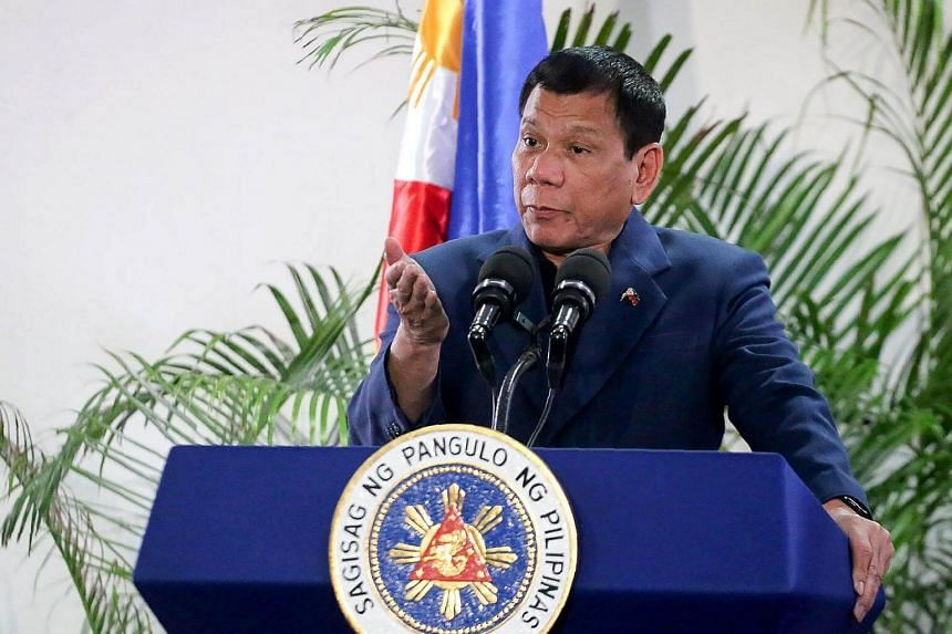 Philippine President Rodrigo Duterte gestures as he speaks at the Davao International Airport after arriving back from a state visit to Brunei and China on Oct 22, 2016.