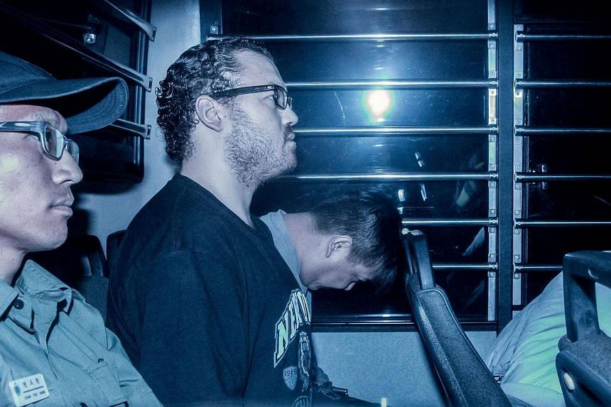 British banker Rurik Jutting (second, left), accused of the murders of two Indonesian women, sitting in a prison van as he arrives at the Eastern Court in Hong Kong on May 8, 2015.