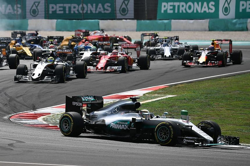 Lewis Hamilton leading the race pack at the start of the Formula One Malaysian Grand Prix in Sepang on Oct 2, 2016.