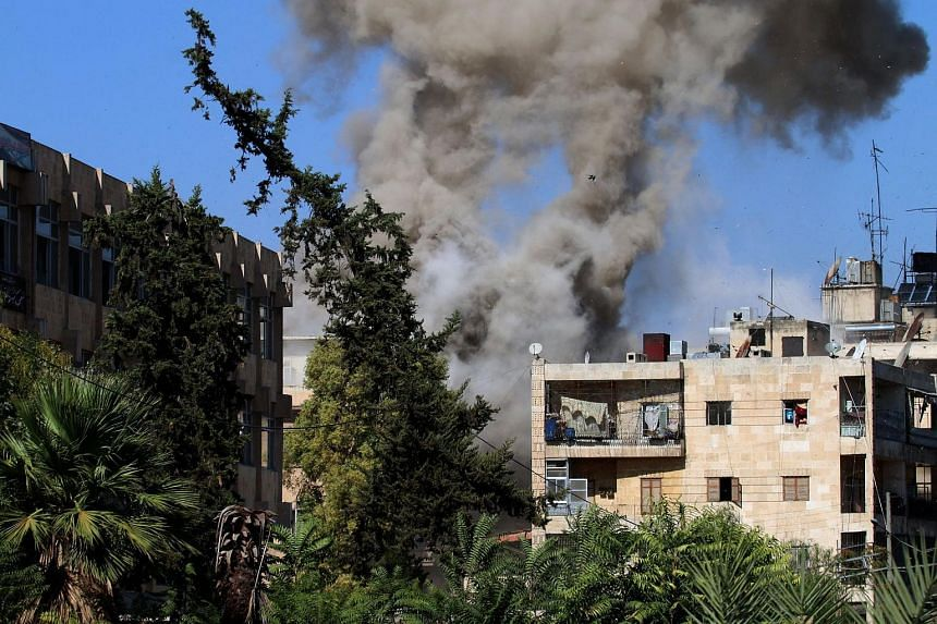 Smoke rises from buildings in Aleppo after clashes erupted on Oct 20, 2016.