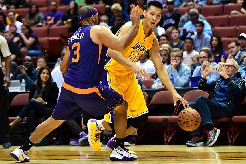 Yi Jianlian #11 of the Los Angeles Lakers attempts to dribble around Jared Dudley #3 of the Phoenix Suns during a preseason game at Honda Centre on Oct 21, 2016.