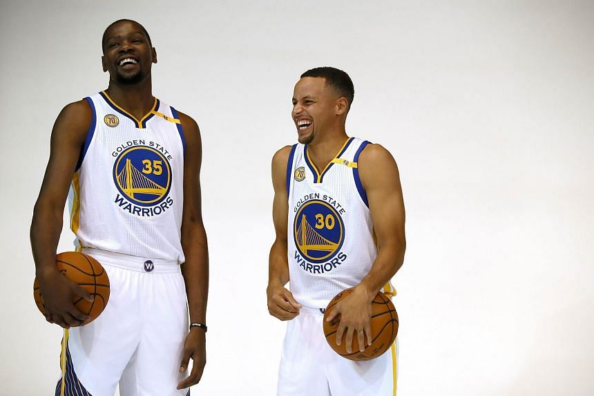 Kevin Durant (#35) and Stephen Curry (#30) of the Golden State Warriors joke while waiting for their pictures to be taken, on Sept 26, 2016.