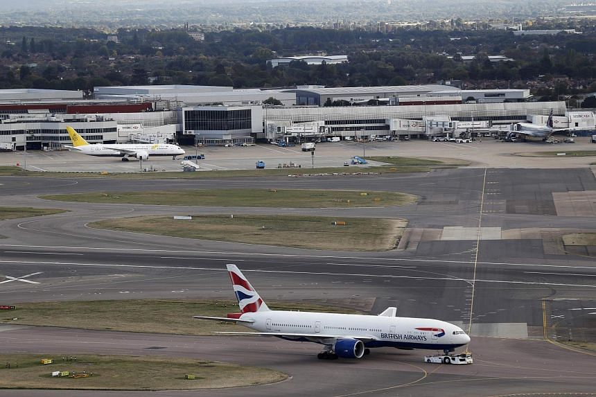 A British Airways passenger plane taxis near Heathrow Airport's Terminal 4, on Oct 11. 2016.