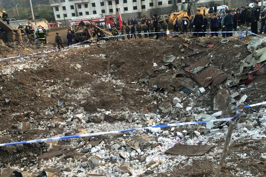 Rescue workers are seen at the site of an explosion in Xinmin, Shaanxi province, on Oct 24, 2016.