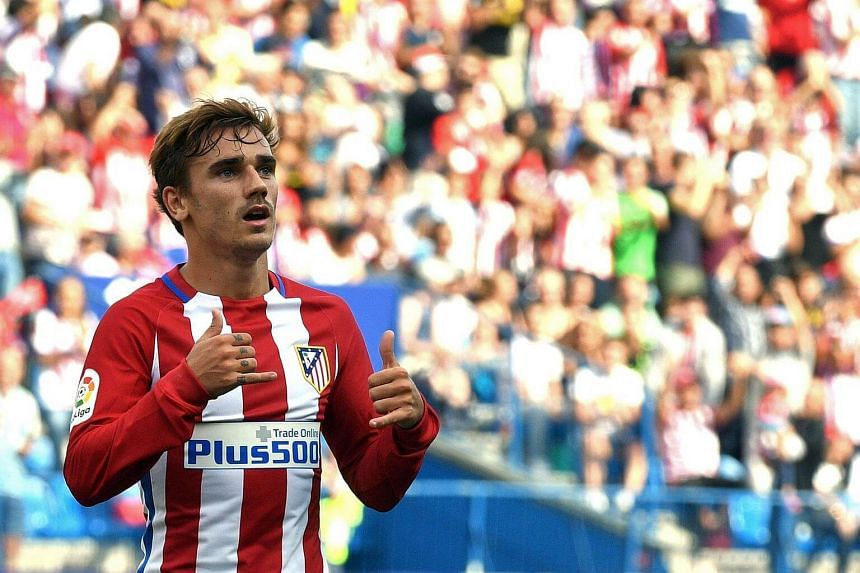 Antoine Griezmann celebrating after scoring during the Spanish league football match between Atletico Madrid vs Sporting de Gijon.