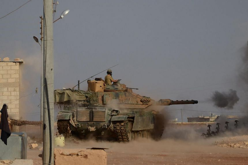 Turkish soldiers firing an upgraded M60 tank near the Syrian village of Beraan, north of Aleppo, on Oct 24, 2016. Turkey said they would be willing to send troops into Iraq in the same way they are fighting in Syria.