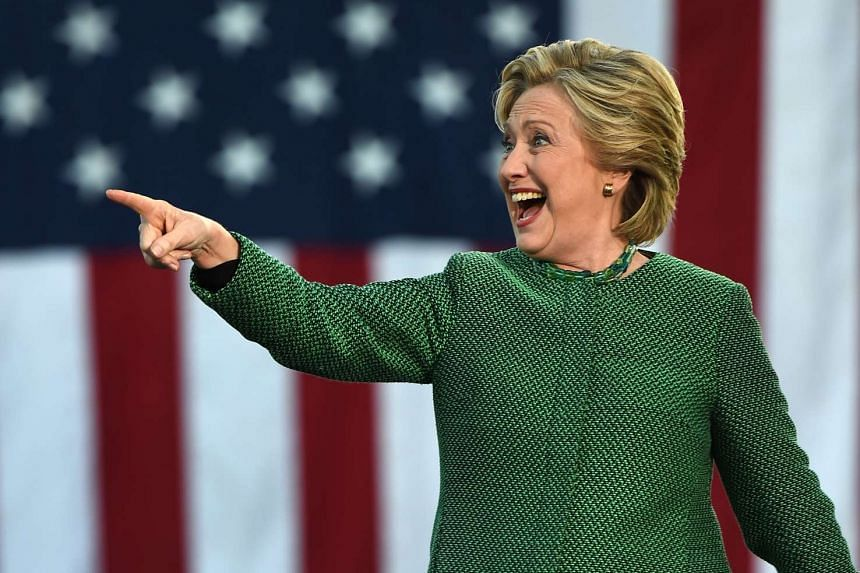 Democratic presidential nominee Hillary Clinton arrives on stage for a rally at the University of North Carolina at Charlotte, on Oct 23, 2016, in Charlotte, North Carolina.