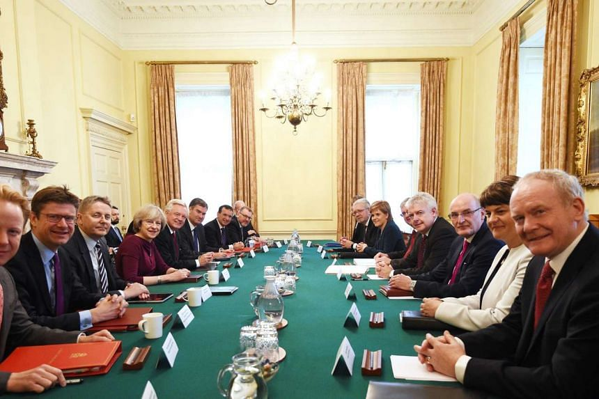 British Prime Minister, Theresa May (4-L) chairs a meeting of the Joint Ministerial Committee, which is also attended by Scottish First Minister Nicola Sturgeon (6-R) , Welsh First Minister Carwyn Jones (4-R), and Northern Irish First Minister Arlene