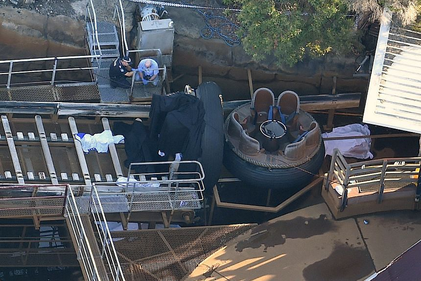 Emergency services personnel can be seen near a ride inside the Dreamworld theme park at Coomera on the Gold Coast, Australia, Oct 25, 2016 after a number of people were reported killed on a ride at Australia's biggest theme park.