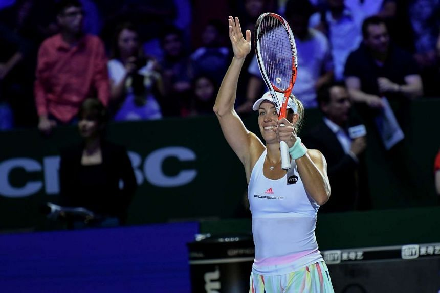 Angelique Kerber celebrating after defeating Simona Halep at the WTA Finals in Singapore on Oct 25, 2016.