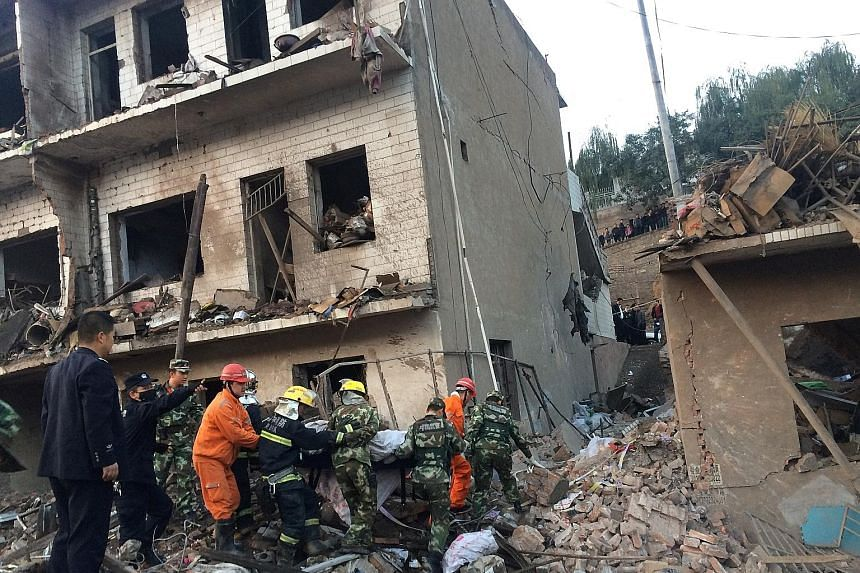 Rescue workers searching for survivors yesterday after an explosion at a prefabricated house in the north-west Chinese province of Shaanxi. At least seven people died and more than 90 were injured, Xinhua news agency reported. The cause of the blast
