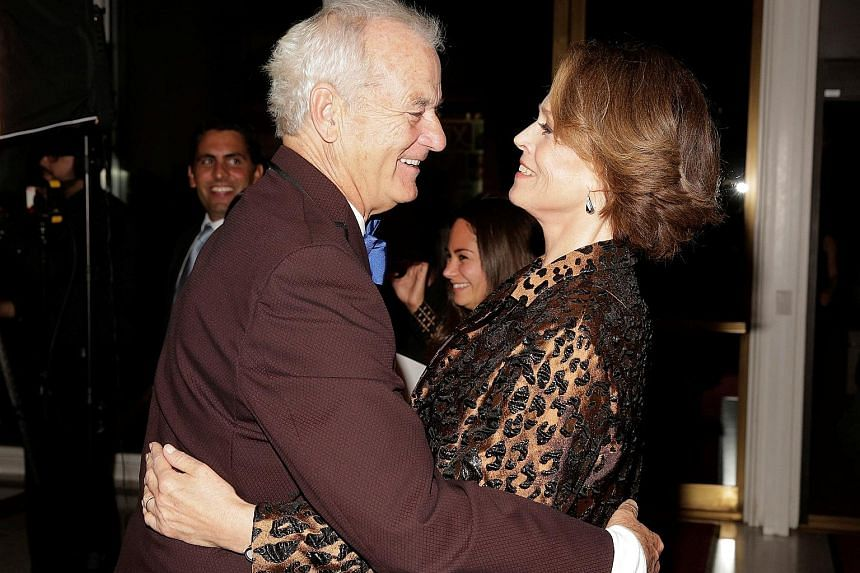 Comedian Bill Murray greets actress Sigourney Weaver (both above) at the Kennedy Center in Washington on Sunday.
