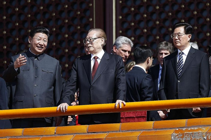 "From left: China's President Xi with former leaders Jiang Zemin and Hu Jintao, at a military parade at Tiananmen Square last year. Being named a ""core leader"" will give Mr Xi a stronger hand to push reforms."