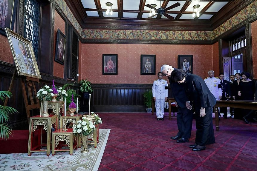 "President Tony Tan Keng Yam and wife Mary paying their respects to the late Thai King Bhumibol Adulyadej at the Grand Palace in Bangkok yesterday. In a Facebook post yesterday, Dr Tan wrote that the late monarch was ""a close friend of many countries,"