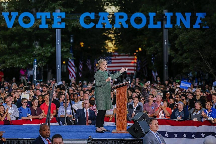 Mrs Clinton at a campaign event at the University of North Carolina in Charlotte on Sunday. She has urged black voters in the state to punish Republican office holders for supporting Mr Trump, even as Mr Trump's party increasingly concedes he is unli
