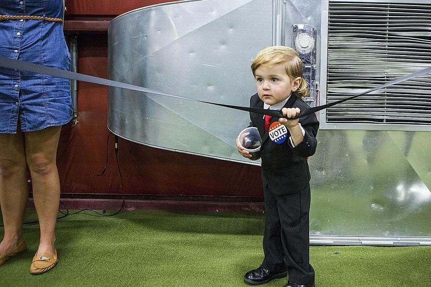 "Two-year-old Hunter Tirpak, dubbed ""Baby Trump"" for his resemblance to the Republican presidential candidate, at a campaign rally on Oct 21 in Pennsylvania."
