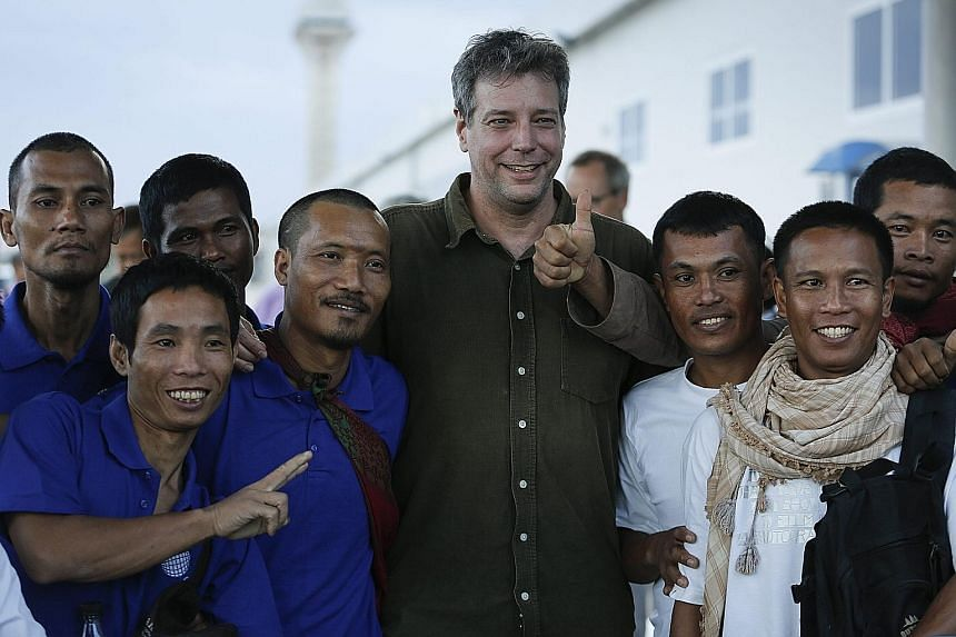 The crew of an Omani-flagged fishing vessel seized nearly five years ago by Somali pirates celebrating their freedom with American writer Michael Scott Moore (centre), who was kidnapped in a separate incident but released in 2014, in Kenya on Sunday.