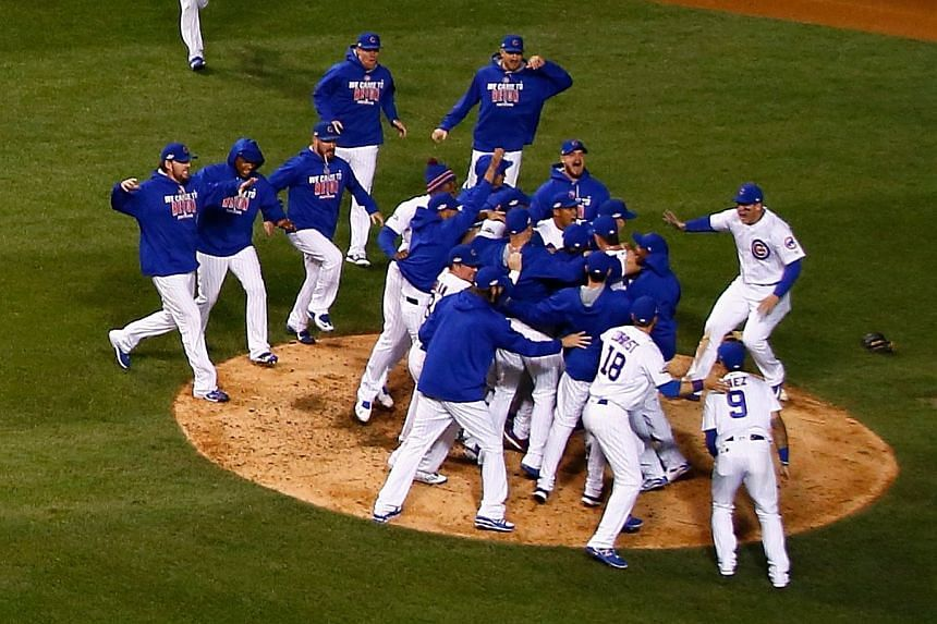The Chicago Cubs celebrate defeating the Los Angeles Dodgers 5-0 in game six of the National League Championship Series to advance to the World Series against the Cleveland Indians.