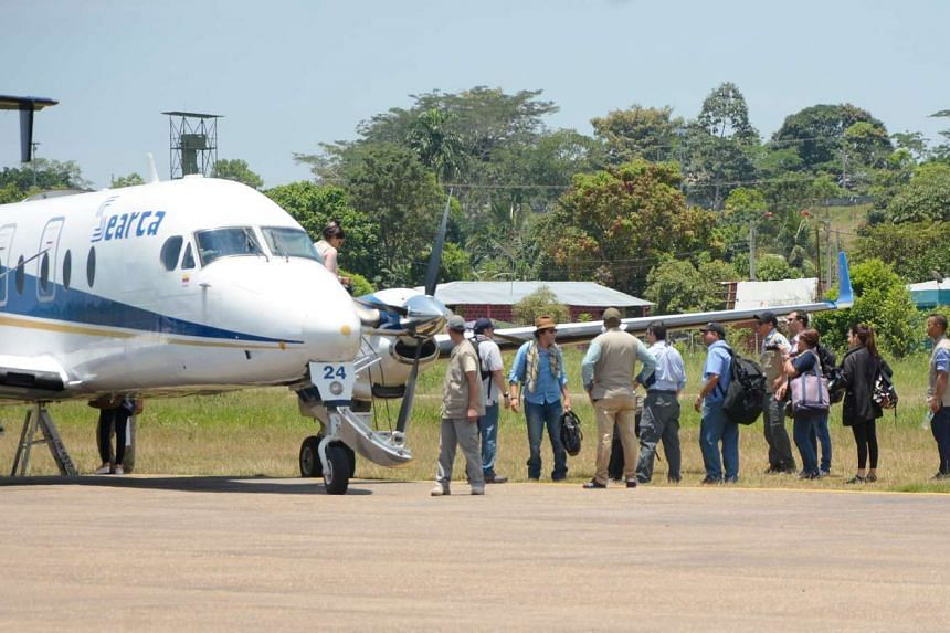 A picture released by the Farc depicting its commanders alighting from a plane on arriving on Sept 12, 2016 at La Macarena, Colombia, to participate in the 10th National Guerilla Conference.