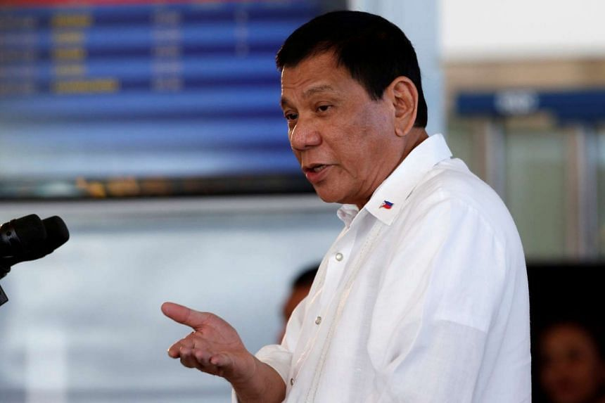 Philippine President Rodrigo Duterte speaking during a news conference at the Ninoy Aquino International airport in Paranaque, Metro Manila, on Oct 25, 2016.