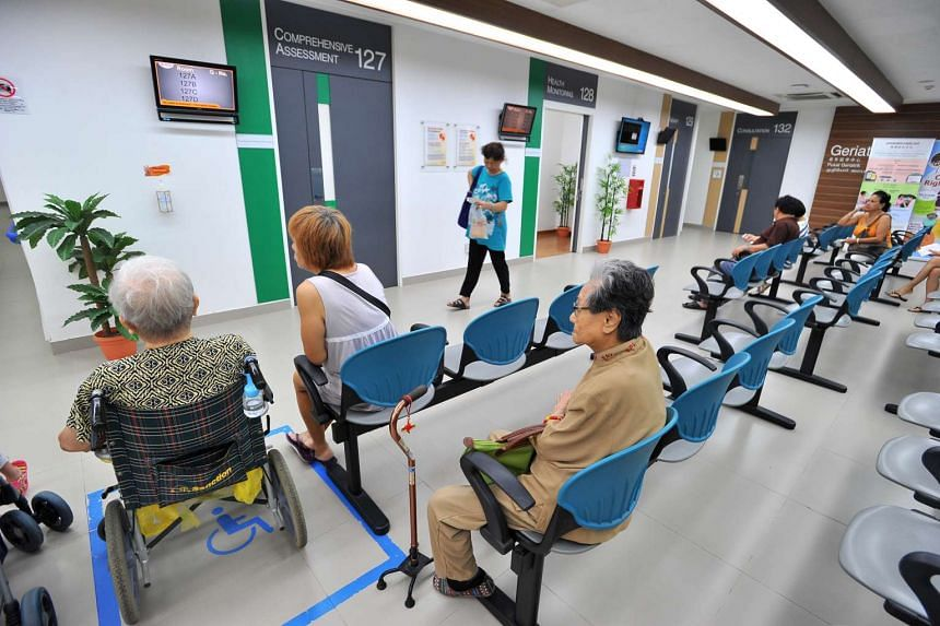 People waiting for their turns at a waiting room at Tampines Polyclinic.