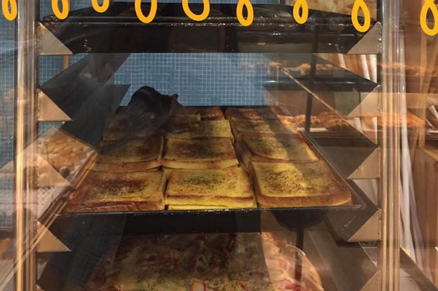 A picture taken by a customer who saw a rat on a tray of freshly baked bread at the Komugi Bakery in Kuala Lumpur's Midvalley Megamall.