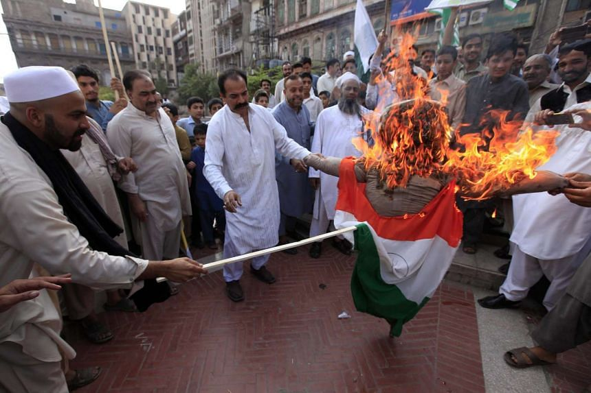 People burn an effigy of Indian Prime Minister Narendera Modi during a protest against India, in Peshawar, Pakistan on October 21 2016. India-Pakistan relations have been tense in recent months, with India blaming Pakistani militants for a raid on an