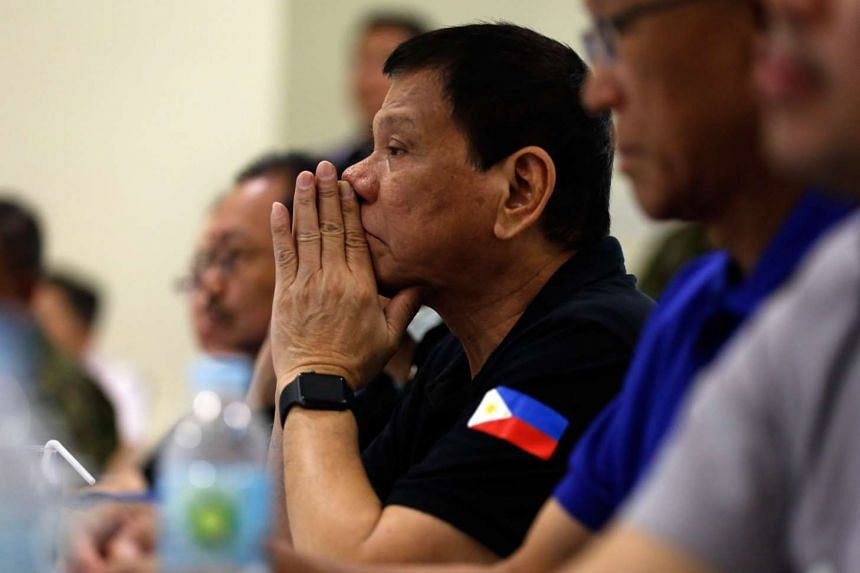 Filipino President Rodrigo Duterte listening during a visit to an affected community in the city of Tuguegarao that was hit by Super Typhoon Haima.