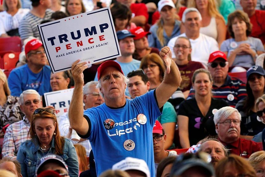 Supporters of Republican US presidential nominee Donald Trump attend a rally in St. Augustine, Florida.