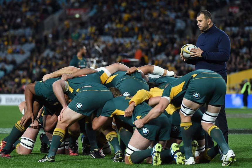Australian rugby coach Michael Cheika (right) gives intructions to players prior to their game of the Bledisloe Cup game against New Zealand in Sydney on Aug 20, 2016.