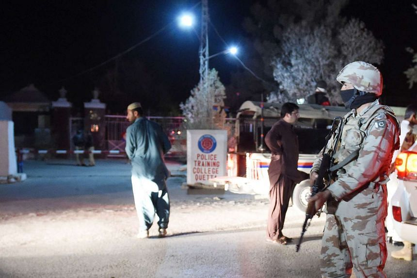 A Pakistani army soldier stands guard outside the Balochistan Police Training College in Quetta after the attack.