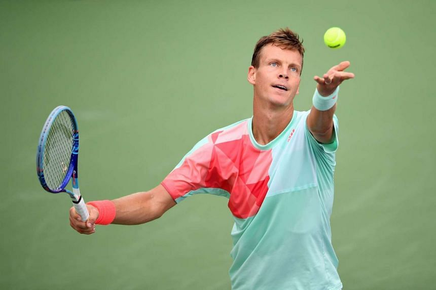 Tomas Berdych of Czech Republic serves against Marcel Granollers of Spain during their men's singles match at the Shanghai Masters tennis tournament in Shanghai on Oct 12, 2016.