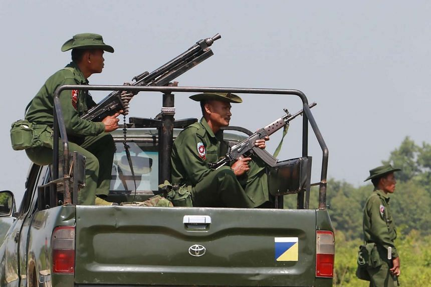 Heavily armed Myanmar army troops patrol the Kyinkanpyin area in Maungdaw town near the Bangladesh border.