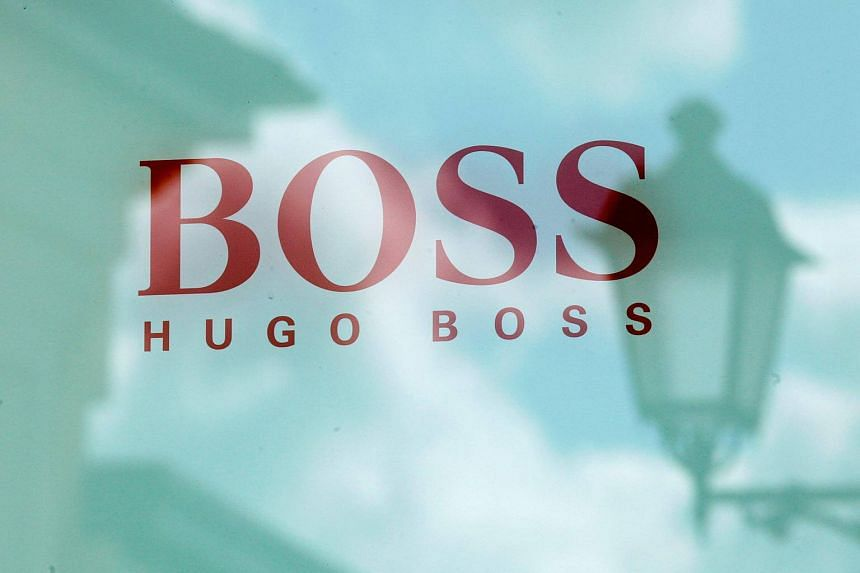 A Hugo Boss store logo is seen at a shopping centre at the outlet village Belaya Dacha outside Moscow.
