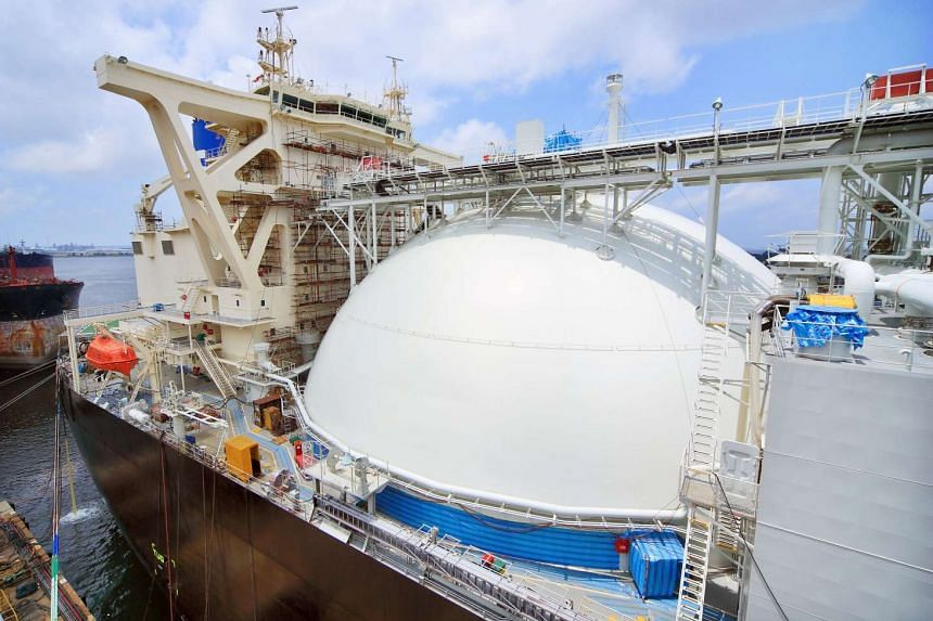 A liquefied natural gas (LNG) carrier undergoes repairs at a shipyard in Singapore.