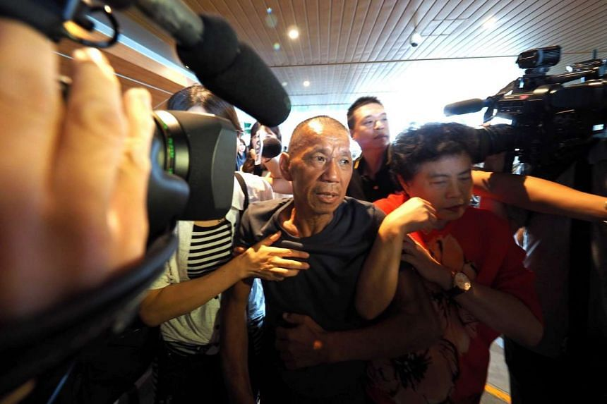 Former hostage Shen Jui-chang (centre) arriving at Taoyuan International Airport, near Taipei, on Oct 26, 2016.