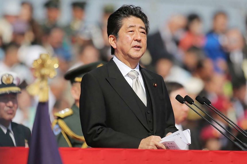 Japanese Prime Minister Shinzo Abe speaking to soldiers of the Ground Self-Defence Force at Camp Asaka in Saitama prefecture, on Oct 23, 2016.