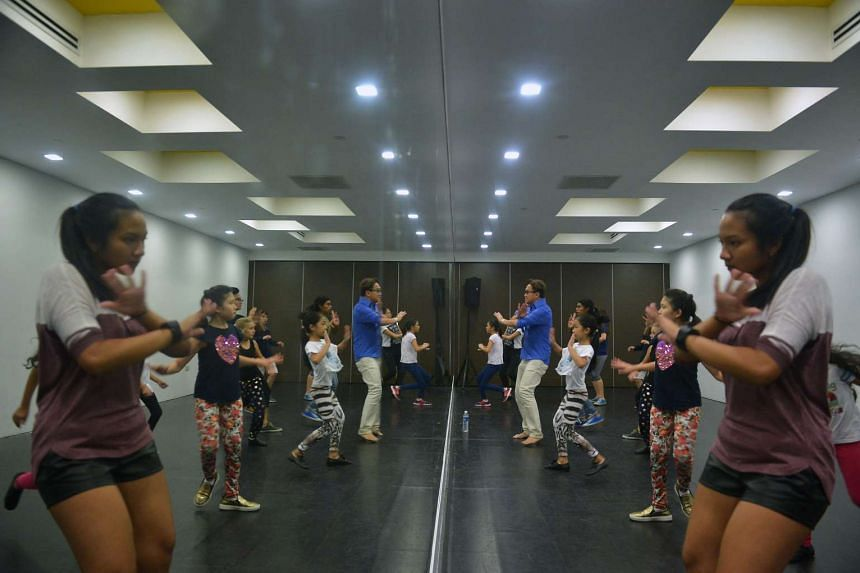 ChildAid 2016 performers take part in a workshop, which includes basic vocals and dance training.
